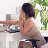 woman on the phone at desk